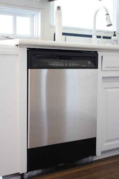 Give your kitchen appliances a stainless steel makeover with stainless steel contact paper. | 36 Genius Ways To Hide The Eyesores In Your Home