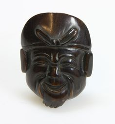 Netsuke of a wooden mask, JAPAN, 1900-1950  signed verso., H 5 - 90 EUR
