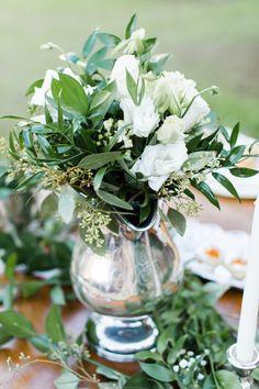 #centerpiece, #pitchers Photography: Caroline Lima Photography - carolinelimaphotography.com Read More: http://www.stylemepretty.com/2014/01/02/rustic-winter-wedding-inspiration/