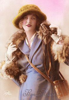 Vintage postcard of lady in purple suit with binoculars.