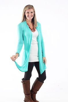 """Turn To Cardigan, Mint $33.00 This cardigan is so simple yet so amazing! The sweet mint color and soft material will have you wanting to wear this one over and over:) The fit of this cardigan is amazing, not to mention the long length is right on trend! Literally throw this over a simple tank or tee and you are ready to go!   Fits true to size. Kalan is wearing the small.   From shoulder to hem:  Small- 33""""  Medium- 34""""  Large- 35"""""""
