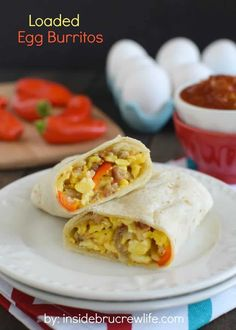 Loaded Egg Burritos - these scrambled egg burritos are loaded with meat, veggies, and cheese for a filling and easy breakfast. Make a batch of freezer burritos for busy mornings. Frozen Breakfast, Breakfast Bites, Breakfast Burritos, Breakfast Sandwiches, Breakfast Meals, Breakfast Casserole, Freezer Cooking, Freezer Meals, Cooking Recipes