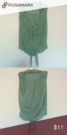 Sleeveless top Sea foam green collared sleeveless top with a tie front, crochet detailing in the front, crossed back, size large but better fit for someone who is a medium Tops Tank Tops