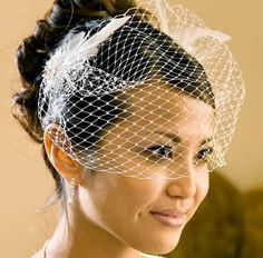 I love how elegant this simple net veil can make any bride look and its a nice way of having a veil, without it being too heavy or covering up the dress. I think this length is best, symmetrical and cut just below the eyes. I reminds me of old school Hollywood glamour and how elegant and romantic everything seems back then. For me, it works best with a smaller dresses like a fishtail and with an up-do, but Im sure it would compliment many styles.