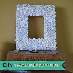 Cupcake liner craft DIY from @savedbyloves. Aha! Perhaps this is a better alternative for my cupcake liners rather than the wreath because I can use plain white ones (which I have). However the question with this is: What is a sizzex machine?