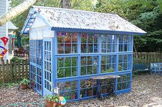 Since there's probably a lot of greenery in your backyard, choosing a bright blue color is the perfect way to make a greenhouse stand out. Learn more at Fine Home Building.
