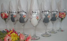 Personalized Bridesmaid Glasses – Hand Painted to replicate the details of your wedding gown, bridesmaid dresses, tuxes flowers and other details of your wedding  {www.samdesigns.net} , $15-$27 ea.