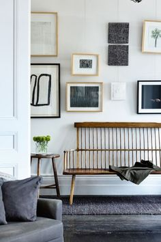gallery wall love! but also that bench.