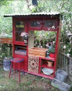 Repurposed entertainment center ~ still entertaining just in a different way!
