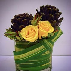 #c2mdesigns #floral #floraldesign #centerpiece #foodie #artichoke #roses #flax #leucadendron #protea #simplicity #weave #event #corporateevent #boston #designsthatrock Designer: #christinemccaffery