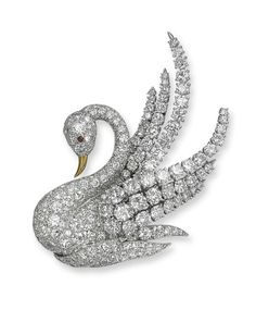 A DIAMOND AND RUBY SWAN BROOCH, BY VAN CLEEF & ARPELS  The pavé-set diamond swan with larger brilliant-cut diamond wings, cabochon ruby eye and gold beak, 7.0 cm, with French assay marks for platinum and gold, in grey suede Van Cleef & Arpels pouch Signed Van Cleef & Arpels, no. 16222