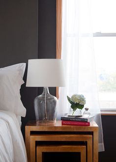 Target Threshold's glass jug lamp sits atop the gilded Astair nesting tables from Z Gallerie. | Editor Makeovers, Lonny.com