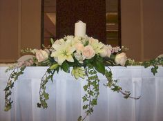 White Lilies and Ivory Roses with Hanging Ivy Head Table Candle Piece