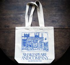 Our classic white tote has a raised blue silkscreen print of the main shop on one side and the Antiquarian shop on the other, an illustration by [[http://geraldinesadlier.com/|Geraldine Sadlier]~external]. Manufactured responsibly from organic cotton by [[http://fairfibers.fr/|Fair Fibers]~external] and screen-printed by our French compatriots at [[www.broceliande-serigraphie.com|Brocéliande Sérigraphie]~external], this sturdy bag will suffice for transporting th...