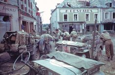 Jeeps (including a press vehicle) in the town square, Marigny (Manche) Normandy, 1944. Frank Scherschel—Time & Life Pictures/Getty Image. The Ruins of Normandy: Rare Color Photos From France, 1944 | LIFE.com