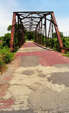 Route 66 Fine Art Photography. A one lane bridge in Sapulpa, Oklahoma, with crumbling concrete and brick roadway. Old-fashioned Rt. 66 is still out there.