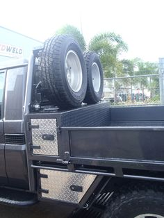 Flatbed extra fuel tank, spare tire carrier and tool box