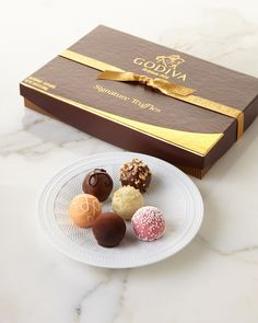 Filled with an assortment of both classic and innovative flavors. Key pieces include Aztec Spice Truffle, Salted Almond Truffle, Strawberry Tarte Truffle, and Creme Brulee Truffle. 12 pieces; net wt.