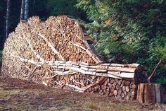 Stacked firewood sculpture by Alastair Heseltine...very cool.