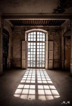 Chateau de Gudanes, France. Upstairs window reflection. Photography by Michael Megaw.