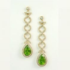This stunning and rare pair of pear shape #Peridots weigh 11.46 carats together and are set in custom made 18K #yellowgold earrings, with 2.50 carats of fine #whitediamonds. The intriguing gallery details and foliate design provide a contemporary yet feminine flair.