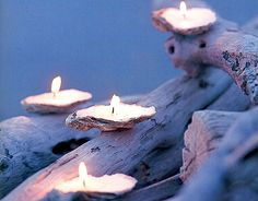 Do it yourself oyster shell candles. Lovely on their own or as a companion to sand candles, these small lights celebrate the beach and the summer. Collect only good-sized empty shells, or save the shells from your next clambake or oyster fest.