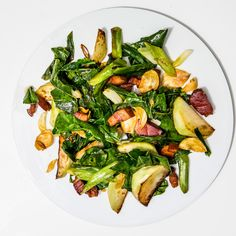 As long as the kohlrabi's greens are fresh-looking and not wilted, you can eat them, like in this stir-fry recipe. They can be sauteéd just like spinach.