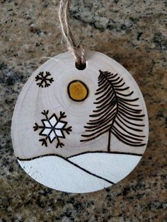 Could be a place card for a Winter Wedding, and doubles as a gift.since it's Christmas. I'm not a fan of guest gifts, but love double duty items. Rustic Snowflake and tree wood burned Christmas ornament - natural wood Wood Slice Crafts, Wood Burning Crafts, Wood Burning Patterns, Wood Burning Art, Rustic Christmas, Handmade Christmas, Christmas Crafts, Christmas Decorations, Wooden Ornaments