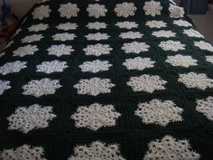 Snowflake Granny Square Afghan Pattern by Joanne Kundra - this pattern was taken down but you can see an alternative here, https://www.craftfoxes.com/blog/one-free-crochet-pattern-many-creative-projects