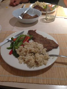 Milanesa (kinda like breaded beef) with rice with egg and grilled peppers