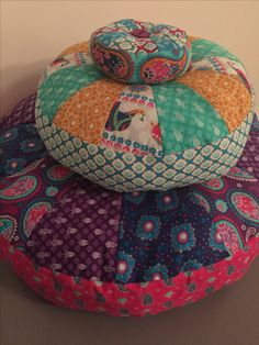 Sprocket pillows made using the Indian Garden fabric range by The Craft Cotton Company