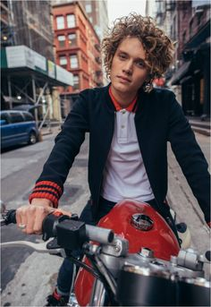 Riding cool in a Gucci black jersey bomber jacket over a white polo trimmed with signature web detail at the collar. Photo Credit: HypeBeast