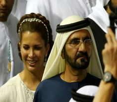 Mohammad bin Rashid al-Maktoum, Ruler of Dubai (R), arrives with his wife princess Haya Bint al-Hussein, to receive the golden trophy after his horse, African Story, won the Dubai World Cup, the world's richest horse race, at the Meydan race track in the Gulf Emirate, 29.03. 2014.