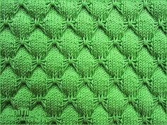 Butterfly stitch - though 20 row repeat only 4 rows to memorize. The reverse looks interesting too. Knitted in a multiple of 10 + 9 sts and 20-row repeat.