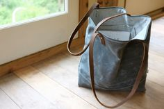 Waxed Canvas Tote - Charcoal Grey - Leather Straps - Organic Cotton Lining. $85.00, via Etsy.