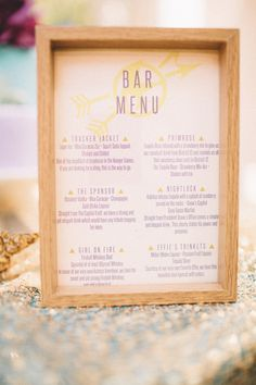 The bar menu was placed in a wooden frame and featured modern signature cocktails inspired by Hunger Games characters. |   Photo by Ed Carlo Garcia Photography (ECG Studios)