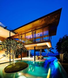Situated in Sentosa Island, Singapore, this modern tropical seaside bungalow was designed by Guz Architects.