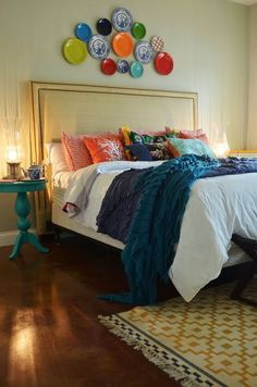 Eclectic bedroom by Life In Grace... love those pillows. definitely trying to go the colorful route now that we have such a lovely, colorful quilt to base it all off of