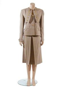 Adrian Houndstooth Check Wool Suit   American, 1940s   Putty and creme checks, the architectural hip length jacket with low narrow square neckline overlaid by faux bolero vest, long tapered set in sleeves, slight shaping, modified Western yoke at back