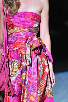 Salvatore Ferragamo.Colors, self tie belts.... matching purse.... it's ALL in the details.