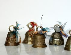 This set of 14 antique brass bells are adorned with unique handmade tassels. Description from erinlouise.com. I searched for this on bing.com/images