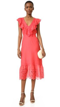 Eyelet ruffles lend a flirty touch to this summery St. Roche dress. Pintucked trim frames the plunging V neckline, and light elastic refines the waist. Hidden side zip. Lined.