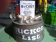 "This has to be one of the most creative displays I have seen!it's a ""mini bucket list""--this has items such as a gourmet canning lesson, a tatoo, a zip line, bungee jump, various lessons and experiences. It's great fun"" Silent Auction Donations, Silent Auction Baskets, Fundraiser Baskets, Raffle Baskets, School Auction, Auction Projects, Fundraising Events, Fundraising Ideas, School Fundraisers"