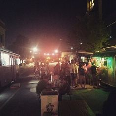 People grabbing a bit to eat at the 2nd Friday Food Truck Park during the 2nd Friday Art Walk in Norman, Oklahoma.