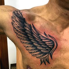 Abstract Guys Small Wings Tattoo On Upper Chest