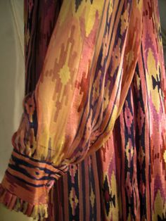 1970s Raksha Ikat Silk Chiffon Print Caftan | From a collection of rare vintage evening dresses at http://www.1stdibs.com/fashion/clothing/evening-dresses/