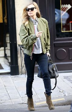 Kate Moss added a dose of shady style to her chill ensemble of jeans, booties and a bomber jacket with demure cat-eye sunnies!