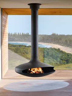 Gyrofocus floating suspended fireplace by Focus Fires Suspended Fireplace, Floating Fireplace, Hanging Fireplace, Wood Fireplace, Modern Fireplace, Fireplace Design, Fireplace Outdoor, Black Fireplace, Focus Fireplaces