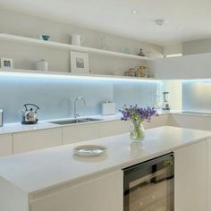 Kitchen in coloured satin matt lacquer with glacier white Corian worktop and back painted glass splashback by INTERIOR ID Kitchen Interior, Kitchen Inspirations, Kitchen Splashback, Glass Kitchen, New Kitchen, Back Painted Glass, Glass Backsplash, Glass Backsplash Kitchen, Kitchen Renovation