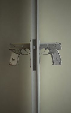 """Bang Bang"" door handle by Russian designer Nikita Kovalev is modeled after the 9mm Makarov semi-automatic pistol"